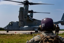 U.S. Marine Corps Cpl. Federico Jaramillo, a pump operator with Marine Wing Support Squadron (MWSS) 172, waits to help refuel an MV-22 Osprey in support of assault support aircraft from 1st Marine Aircraft Wing during Operation Lightning Strike, Aug. 6, 2020, at Ie Shima Training Facility, Okinawa, Japan. The purpose of the training was to prepare Prospective Weapons and Tactics Instructor (PWTI) students for what to expect when they attend future WTI courses. MWSS 172's role was to provide the Forward Arming and Refueling Point to expand the combat radius and allow aviation ground support closer to the objective. (U.S. Marine Corps photo by Lance Cpl. Karis Mattingly)
