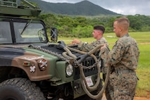 U.S. Marines with Marine Air Support Squadron 2, Marine Heavy Helicopter Squadron 462,1st Marine Aircraft Wing, along with Combat Logistics Battalion 4, 3rd Marine Logistics Group, prepare a vehicle for an external lift at Okinawa, Japan, Sept. 22, 2020. The units prepared the Direct Air Support Center's Communication Vehicle for an external lift to improve their expeditionary capabilities. (U.S. Marine Corps photo by Lance Cpl. Dalton J. Payne)