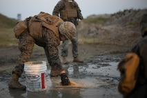 U.S Marines with Marine Wing Support Squadron 171 repair damage to a concrete slab that simulates damage to an airfield during Exercise Active Shield aboard Marine Corps Air Station (MCAS) Iwakuni, Japan, Oct. 29, 2020. Active Shield is an annual bilateral exercise partnering U.S. and Japanese forces for the protection and defense of MCAS Iwakuni and other assets in the region in order to sustain military operations in support of the U.S.-Japan Alliance. (U.S. Marine Corps photo by Lance Cpl. Bryant Rodriguez)