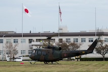 Japan Ground Self-Defense Force (JGSDF) Maj. Gen. Yasuyuki Kodama, commander of the 13th Brigade, arrives in a UH-1 Iroquois helicopter during Exercise Active Shield aboard Marine Corps Air Station (MCAS) Iwakuni, Japan, Oct. 28, 2020. The purpose of the visit was to observe U.S. and JGSDF service members working together during the exercise. Active Shield is an annual bilateral exercise partnering U.S. and Japanese forces for the protection and defense of MCAS Iwakuni and other assets in the region in order to sustain military operations in support of the U.S.-Japan Alliance. (U.S. Marine Corps photo by Lance Cpl. Tyler Harmon)
