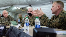 U.S. Marine Corps Gen. David H. Berger, 38th commandant of the Marine Corps, and Sgt. Maj. of the Marine Corps Troy E. Black, attend a 1st Marine Aircraft Wing (MAW) operational brief during Exercise Driven Thermite 21 at Marine Corps Air Station Futenma, Okinawa, Japan, Nov. 16, 2020. This exercise ensures that 1st Marine Aircraft Wing (MAW) personnel are ready to plan and execute air operations in the Indo-Pacific by operating in a simulated environment. (U.S. Marine Corps photo by Capt. Karen Jensen)
