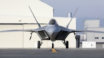 U.S. Air Force F-22 Raptor with the 94th Fighter Squadron taxis the runway at Marine Corps Air Station Iwakuni, Japan, Nov. 19, 2020. The F-35 Lightning II and the F-22 Raptor, both 5th generation fighter aircraft, represent the pinnacle of advanced fighter attack aircraft capabilities and are strategically forward-postured in the Indo-Pacific to maintain regional peace and security. (U.S. Marine Corps photo by Cpl. Jackson Ricker)