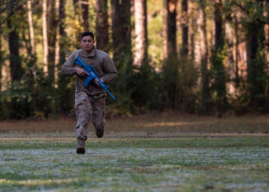 Staff Sgt. Jose Flores, 4th Civil Engineer Squadron pavement and equipment operator, runs across a field during Prime Base Engineer Emergency Force training at Seymour Johnson Air Force Base, North Carolina, Nov. 19, 2020.