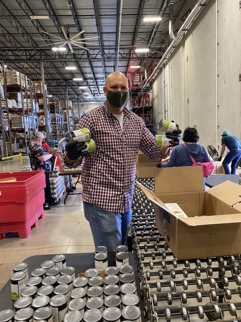 Jeff Whittaker, NSA-Texas E&P deputy director, packages cans of food.