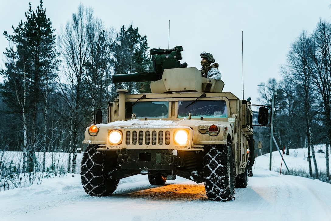 U.S. Marines start their High Mobility Multipurpose Wheeled Vehicle's engine during Exercise Reindeer II in Setermoen, Norway, Nov. 26.