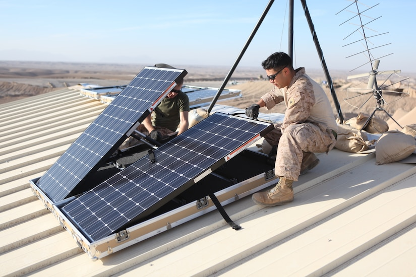 U.S. Marine Corps Cpl. Robert G. Sutton, left, and Cpl. Moses E. Perez, field wireman with Combat Logistics Regiment 15 install new solar panels on Combat Outpost Shukvani, Helmand province, Afghanistan, Nov. 19, 2012.