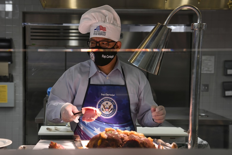 Rep. Salud Carbajal, United States Congressman, serves Thanksgiving meals to military and base members at the Breakers Dining Facility Nov. 26, 2020, at Vandenberg Air Force Base, Calif.