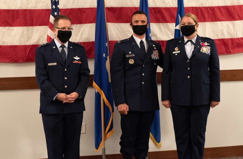 U.S. Air Force Col. Shelley Woodworth, right, stands with her husband U.S. Air Force Col. Travis Woodworth, center, and U.S. Air Force Lt. Gen. Jim Slife, Air Force Special Operations Commander, during her retirement ceremony on Nov. 24, 2020.