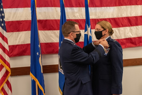 U.S. Air Force Lt. Gen. Jim Slife, commander of Air Force Special Operations Command, pins the Legion of Merit on U.S. Air Force Col. Shelley Woodworth during her retirement ceremony on Nov. 23, 2020. Woodworth was the first female AFSOC pilot and retired with 3,500 flying hours.