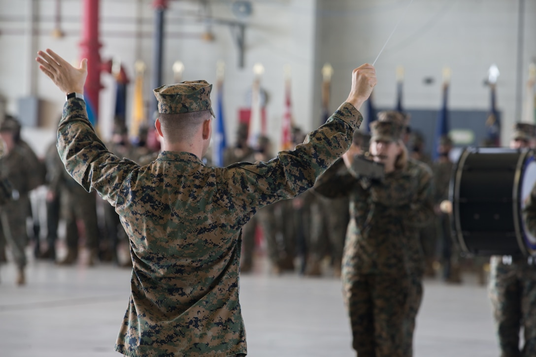 A conductor directs the playing of the 2nd Marine Aircraft Wing band during a relief and appointment ceremony at Marine Corps Air Station Cherry Point (MCAS), North Carolina, Nov. 6, 2020. The ceremony was held to transition the position of Headquarters and Headquarters Squadron sergeant major from Sgt. Maj. Thomas J. Korabik Jr., to Sgt. Maj. James I. Petty. (U.S. Marine Corps photo by Lance Cpl. Jacob Bertram)