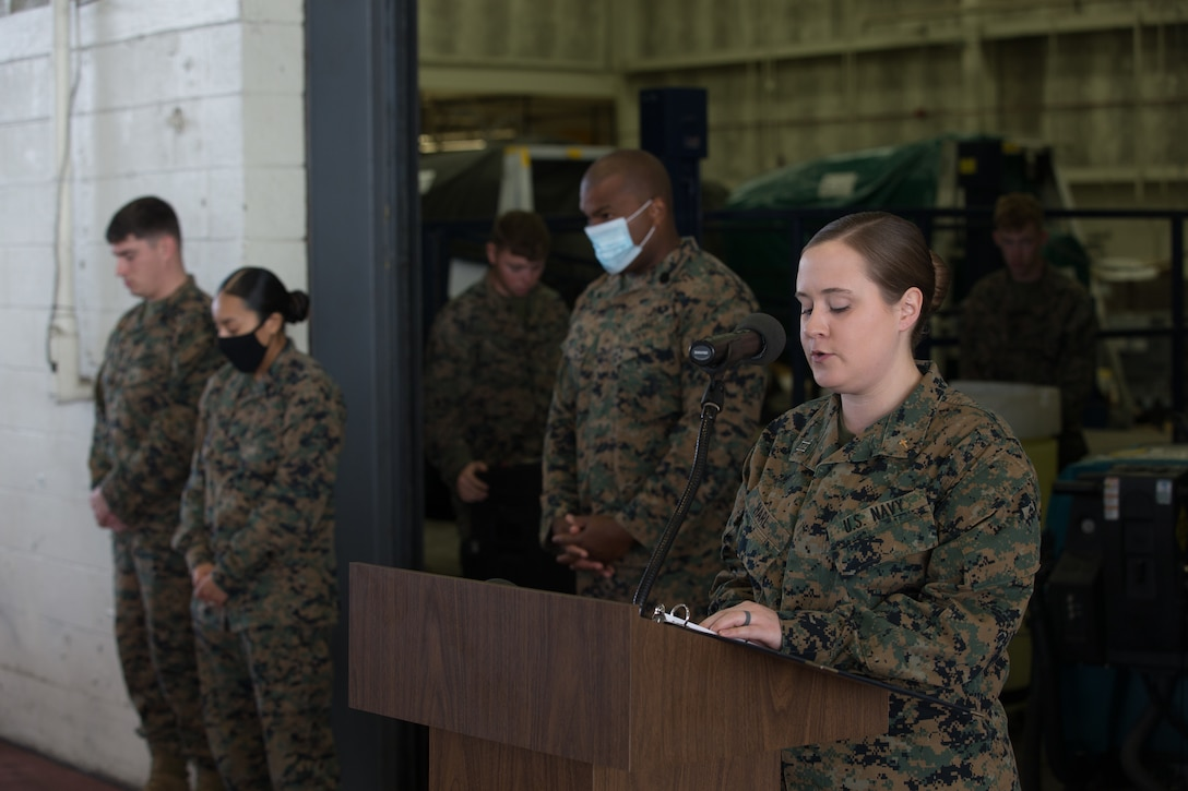U.S. Navy Lt. Ailsa Harl, the Marine Corps Air Station (MCAS) Cherry Point, North Carolina, station chaplain, says a prayer during a relief and appointment ceremony at MCAS Cherry Point, North Carolina, Nov. 6, 2020. The ceremony was held to transition the position of Headquarters and Headquarters Squadron sergeant major from Sgt. Maj. Thomas J. Korabik Jr. to Sgt. Maj. James I. Petty. (U.S. Marine Corps photo by Lance Cpl. Jacob Bertram)