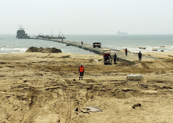 A U.S. Army Landing Craft Utility 2000 offloads equipment to a Trident Pier at Anmyeon Beach on the west coast of the Republic of Korea during exercise Combined Joint Logistics Over-the-Shore (LOTS) 2015.  CJLOTS 2015 is an exercise designed to train U.S. and ROK service members to accomplish vital logistical measures in a strategic area while strengthening communication and cooperation in the U.S.-ROK alliance.