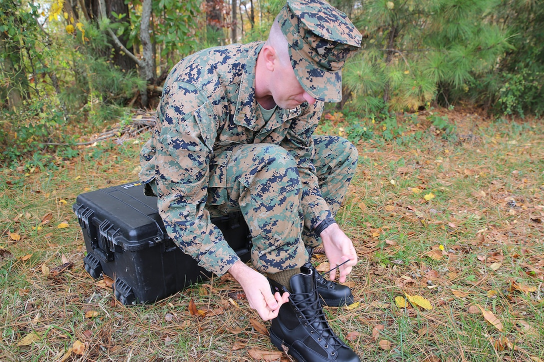 Capt. Caleb Haney, a project officer with the Program Manager for Infantry Combat Equipment at Marine Corps Systems Command, assembles the Marine Corps Intense Cold Weather Boot Nov. 13 aboard Marine Corps Base Quantico, Virginia. Scheduled to field in fiscal year 2021, the ICWB is full-grain, leather boot designed for use in temperatures as cold as -20 degrees Fahrenheit. (U.S. Marine Corps photo by Matt Gonzales)