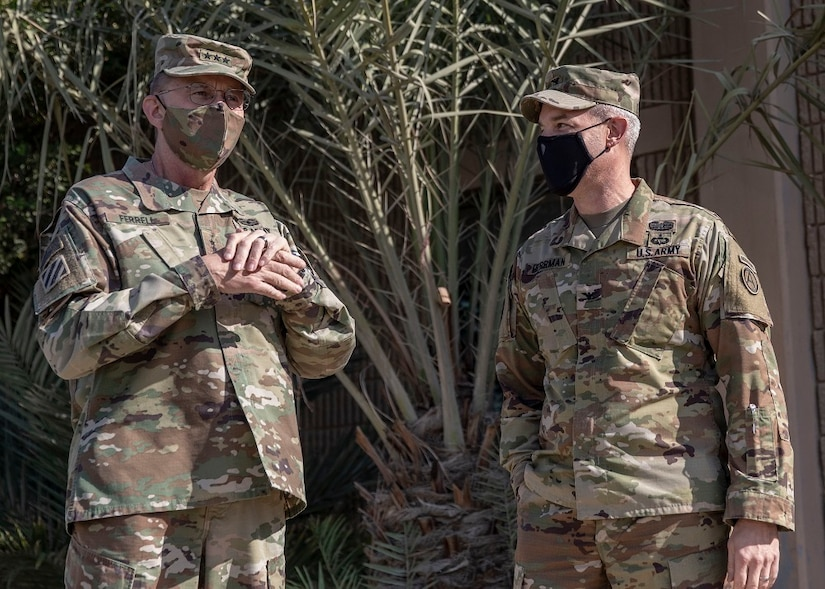 U.S. Army Lt. Gen. Terry Ferrell, U.S. Army Central commanding general, speaks with Col. John J. Herrman, commander of Area Support Group - Kuwait, before a coin ceremony on Camp Arifjan, Kuwait, November 19, 2020. Ferrell presented Soldiers at ASG-KU with the Commander's Coin of Excellence, a ceremonial token recognizing those who demonstrate exemplary performance in their assigned duties. (U.S. Army Reserve photo by Sgt. Khylee Woodford)