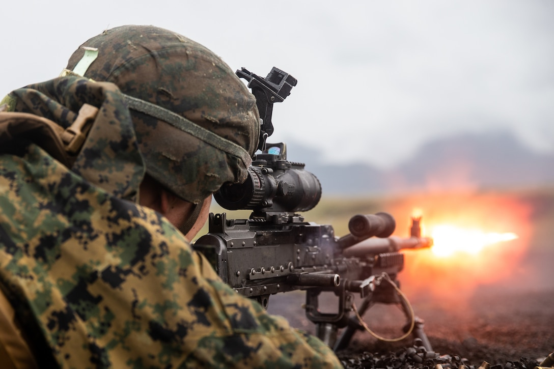 A U.S. Marine fires an M240B machine gun in a live-fire range at Combined Arms Training Center, Camp Fuji, Japan, Oct. 8.