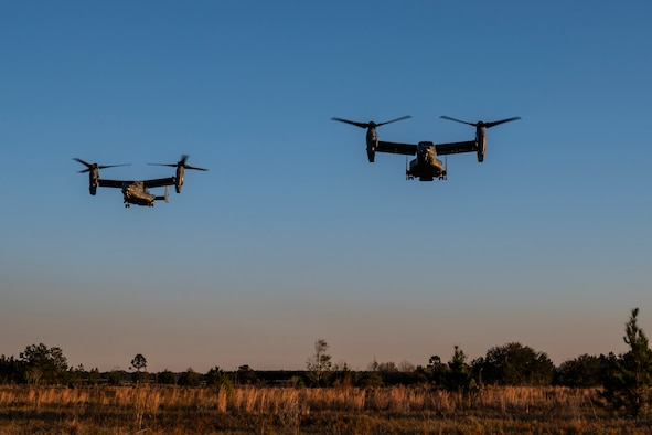 Two CV-22B Osprey tiltrotor aircraft assigned to the 8th Special Operations Squadron approach for landings above northwest Florida, Nov. 16, 2020. The Osprey combines the vertical takeoff, landing and hover capabilities of a helicopter with the long-range, fuel efficient and speed characteristics of a turboprop aircraft. (U.S. Air Force photo by Staff Sgt. Joseph Pick)
