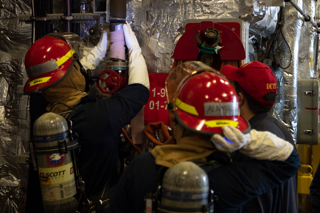 Sailors aboard Independence-variant littoral combat ship USS Gabrielle Giffords (LCS 10) demonstrate pipe patching during damage control drills November 28, 2020.