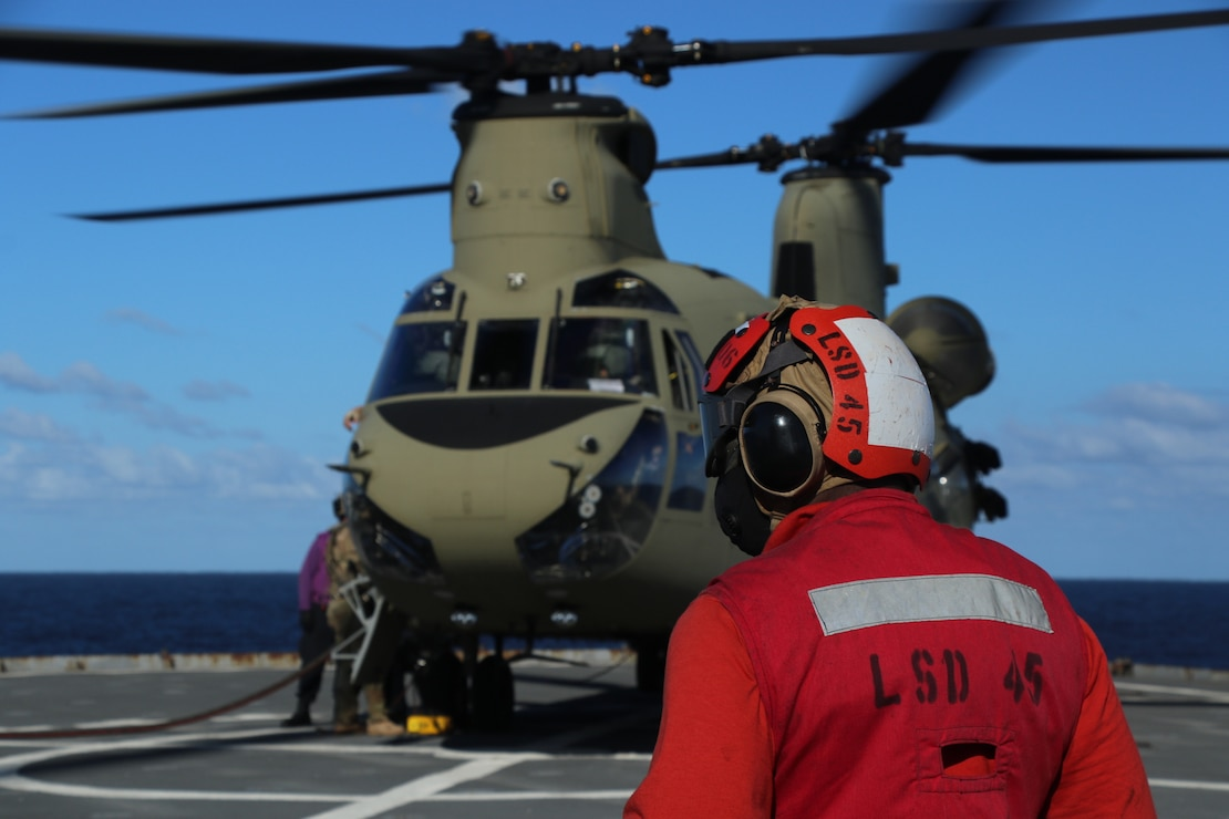 Sailors aboard the amphibious dock landing ship USS Comstock (LSD 45) conduct flight operations in support of U.S. Southern Command�s Hurricane Iota relief efforts in Central America, Nov. 29, 2020.