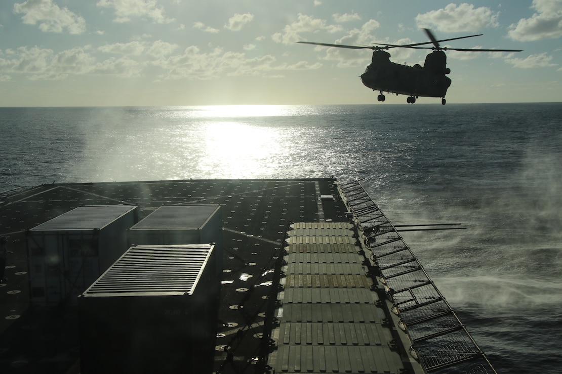 A CH-47 Chinook helicopter flies above the flight deck of USS Comstock (LSD 45) during flight quarters in support of U.S. Southern Command�s Hurricane Iota relief efforts in Central America, Nov. 29, 2020.