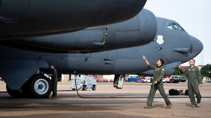 "Capt. John ""Heater"" Alora, 20th Bomb Squadron pilot, shows Chief Master Sgt. Brent ""Chip"" Chadick, 2nd Bomb Wing command chief, how to perform preflight inspections on a B-52H Stratofortress at Barksdale Air Force Base, La., Sept. 2, 2020."