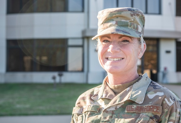 An Airman smiles for a photo