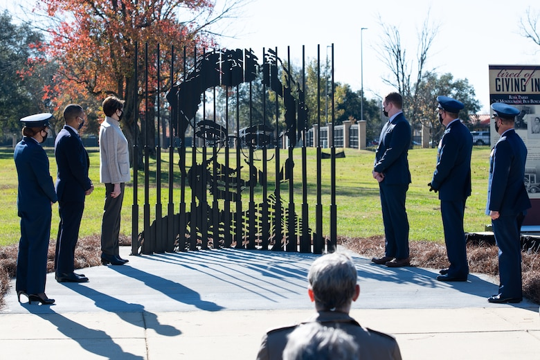 Col. Eries Mentzer, 42nd Air Base Wing commander, is joined by Secretary of the Air Force Barbara Barrett and other distinguished visitors Dec. 1, 2020, for the unveiling of a Rosa Parks memorial sculpture. Many people may know of the work Rosa Parks did during the civil rights movement, but less may know she worked on Maxwell Air Force Base in the 1940s. (U.S. Air Force photo by Senior Airman Charles Welty)