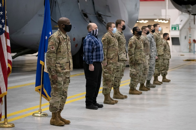 U.S. Air Force Col. Travolis A. Simmons, the commander of the 3rd Wing, awards Joint Service Achievement Medals to Airmen from the 3rd Maintenance Squadron for their participation in the recovery effort during Operation Colony Glacier at Joint Base Elmendorf-Richardson, Alaska, Nov. 30, 2020.