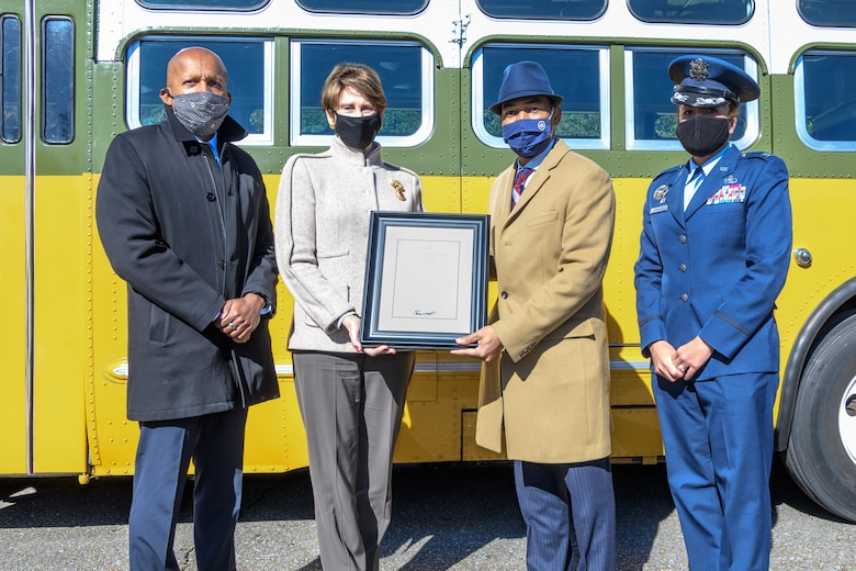 "Bryan Stevenson, Equal Justice Initiative director (left), Secretary of the Air Force Barbara Barrett, Mayor of Montgomery Steven Reed and Col. Eries Mentzer, 42nd Air Base Wing commander, pose for a photo on Maxwell Air Force Base, Alabama, Dec. 1, 2020, the 65th anniversary of her arrest for refusing to give up her seat on a Montgomery bus. The event marks the start of a 382-day partnership between Maxwell and the city of Montgomery. The partnership's aim is to focus on diversity and inclusion so everyone can ""rise to their best,"" said Mentzer. To make this possible, she formed the Freedom to Serve Initiative, a team of Airmen whose goal is to identify and find solutions to obstacles that may impede Airmen's success. (U.S. Air Force photo by Trey Ward)"