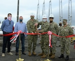 Capt. Edward Pidgeon, center left, commanding officer of Naval Supply Systems Command Fleet Logistics Center Yokosuka, and Lt. Cmdr. Eric Martorano, center right, are joined by staff and a contractor from Gilbane Building Company during a ribbon cutting to celebrate the completion of a pipeline repair project at Defense Fuel Service Point Hakozaki.