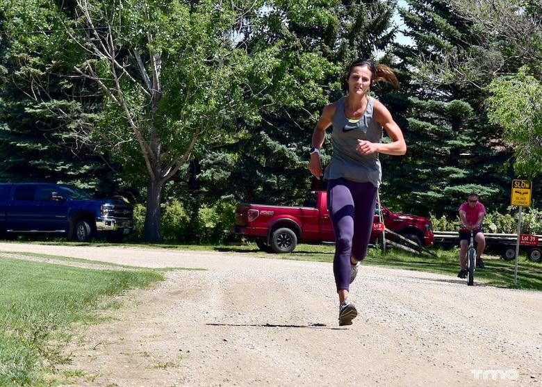 Runner in the Hide Away Bay 5K Race trails the Douglas Creek Recreation Area at Lake Sakakawea in North Dakota, June 20, 2020.