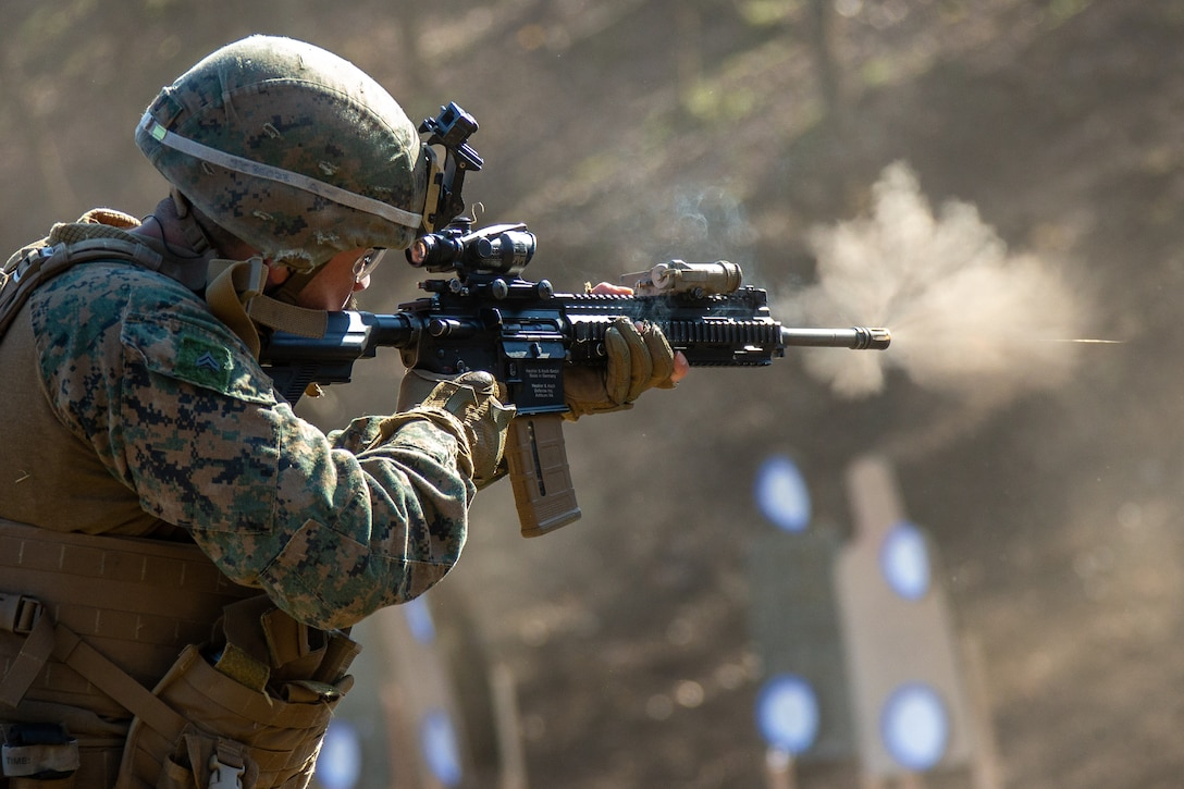 A U.S. Marine fires an M27 Infantry Automatic Rifle during advanced marksmanship drills at exercise Fuji Viper 21.1 at Combined Arms Training Center, Camp Fuji, Japan, on Nov. 4.