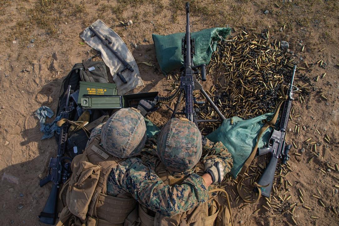 U.S. Marines fire an M240B machine gun during a team defense range as part of MEFEX 21.1 at Fort Drum, New York, Nov. 6.