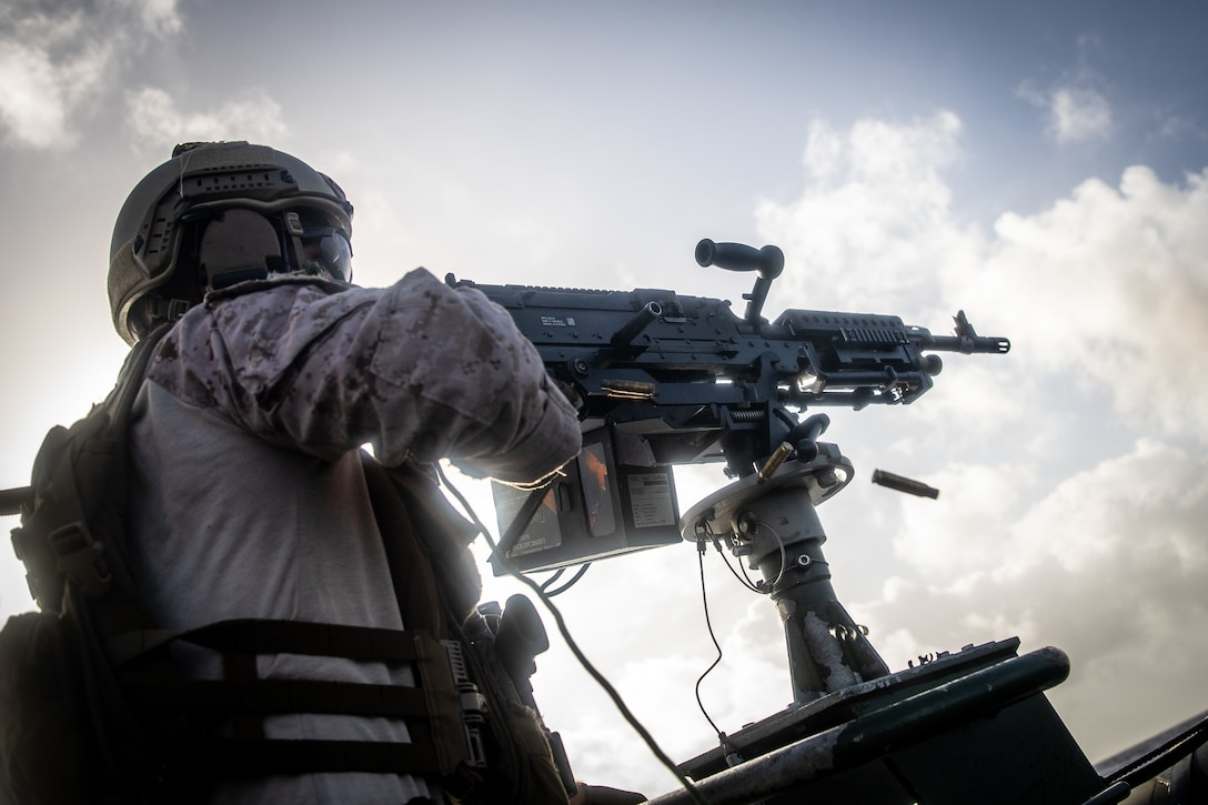 A U.S. Marine fires at targets during a live fire machine gun shoot with Netherlands Marines from the 32nd Raiding Squadron near Netherlands Marine Barracks Savaneta, Aruba, Nov. 23.
