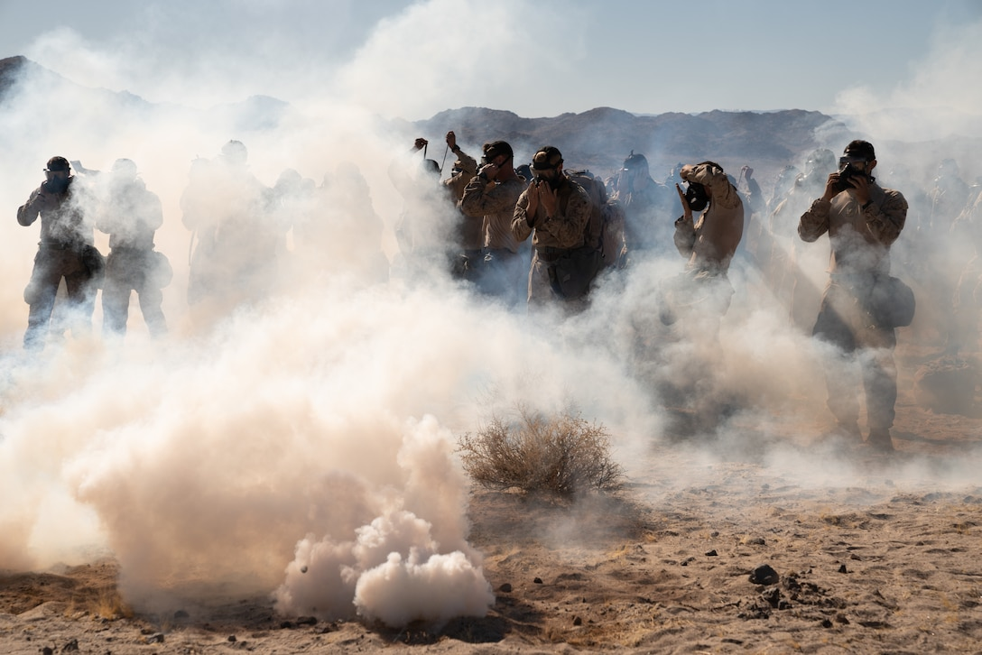 U.S. Marines utilize M50 gas masks during a chemical, biological, radiological and nuclear defense training exercise at Marine Corps Air Ground Combat Center, Twentynine Palms, California, Nov. 19.