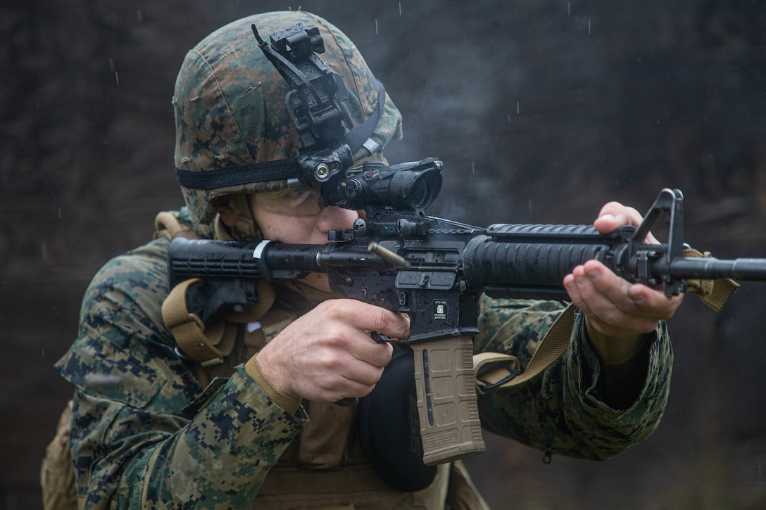 A U.S. Marine fires an M4 carbine during military operations on urbanized terrain training as part of Marine Expeditionary Force 20.1 on Fort Drum, New York Nov. 1.