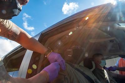 Hawaii medical Airmen conduct drive-thru flu vaccinations