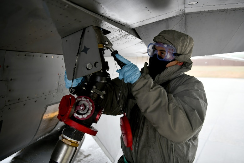 U.S. Air Force Staff Sgt. Andrew Bueno, 555th Aircraft Maintenance Unit crew chief, attaches a fueling line to an F-16 Fighting Falcon at Aviano Air Base, Italy, Dec. 2, 2020. Crew chiefs work alongside many other career fields in the Air Force to ensure the upkeep of aircraft assigned to the wing. Maintenance airmen work around the clock, often in less-than-ideal weather conditions, to keep the wing mission-ready. (U.S. Air Force photo by Staff Sgt. K. Tucker Owen)