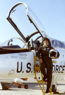 Col. Kathleen Conley, poses next to her aircraft. was a 1980 distinguished graduate of the Air Force Academy and the Academy's first female graduate. (Courtesy Photo)