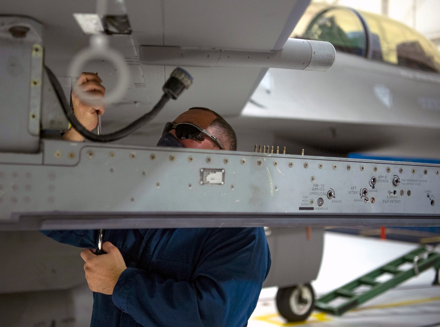 Tech. Sgt. Joseph Ramos, 149th Fighter Wing aircraft armament systems technician, removes a panel from an F-16 Fighting Falcon undergoing maintenance Nov. 30 at Joint Base San Antonio-Lackland.