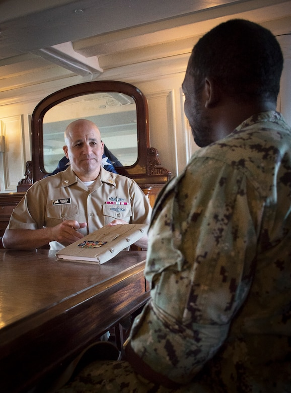 Master Chief Petty Officer of the Navy Russell Smith mentors a chief petty officer selectee.