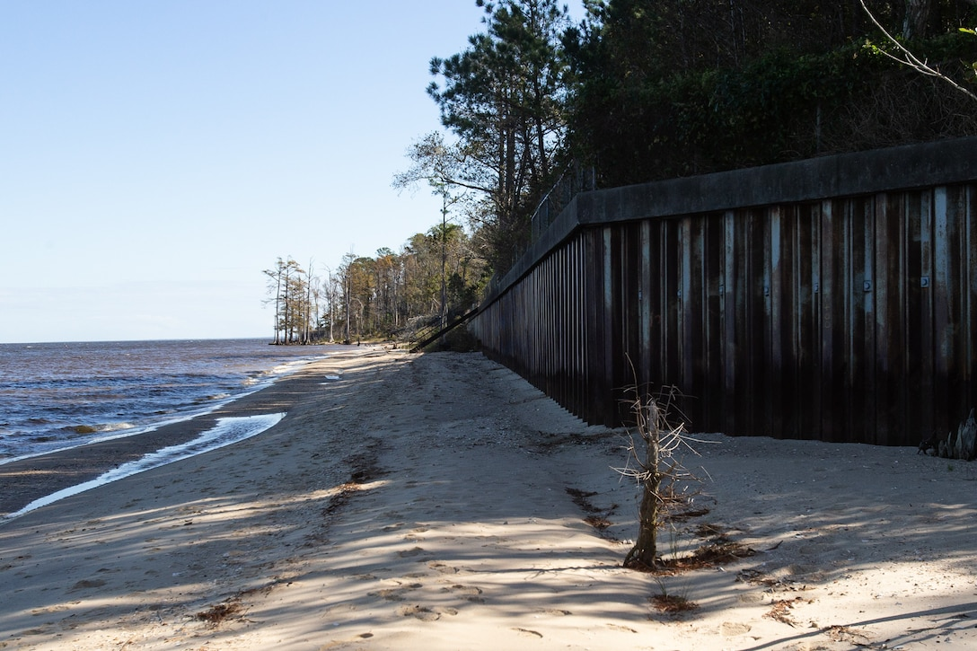 A seawall stands along the shores of Marine Corps Air Station Cherry Point, North Carolina, Nov. 5, 2020. This border protects the shoreline from erosion and storm damage. Since Hurricane Florence Cherry Point Environmental Affairs Department has been working to secure funding to repair the damage and make extensive long-lasting improvements to the shoreline's design. (U.S. Marine Corps photo by Cpl. Alexandra Amor Santos Arambulo)