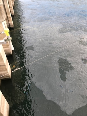 Oil sheen seen in at The Dalles Dam on the Columbia River, Dec. 3, 2020. On Thursday, a thrust hub cooling water pipe broke, spilling up to 200 gallons of oil into the Columbia River at The Dalles Dam. The equipment is part of a fish unit turbine designed to provide attraction water for migrating fish.