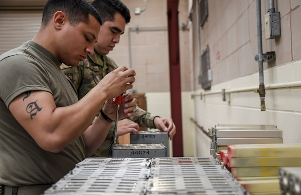 Airman 1st Class Anthony Acosta and Airman 1st Class John Aldecoa, 144th Maintenance Squadron, breaks down countermeasures to be stored and shipped back to Fresno, California, during the exercise Checkered Flag, Tyndall Air Force Base, Florida, Nov. 9, 2020.