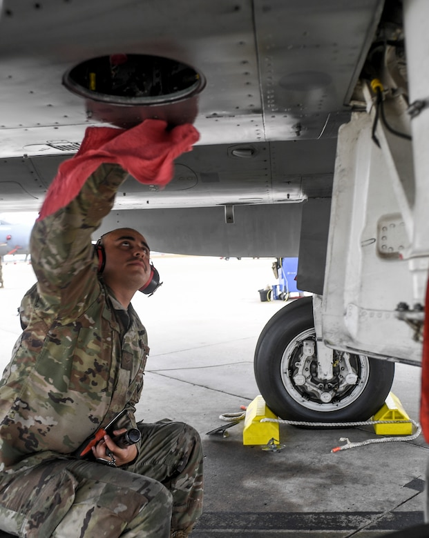Airman 1st Class Bailey Zavala prepare a U.S. Air Force F-15C Eagle fighter jet to launch during during the exercise Checkered Flag, Tyndall Air Force Base, Florida, Nov. 10, 2020.