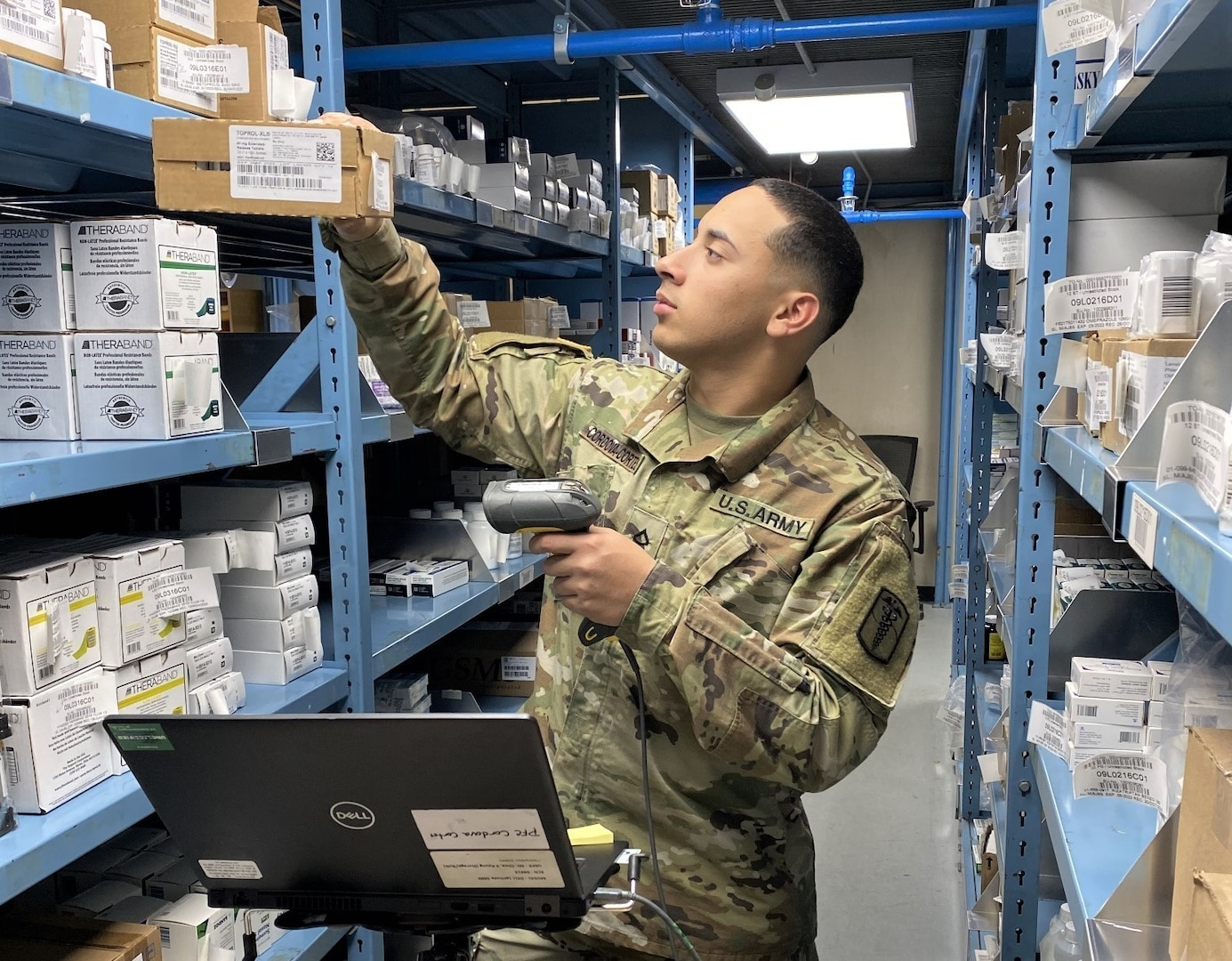 Pfc. Raul Cordova performs duties as a storage materiel handler at the U.S. Army Medical Materiel Center-Korea warehouse. His duties include picking of Class VIII medical supplies and transferring them over to the shipping section for shipment to customers.