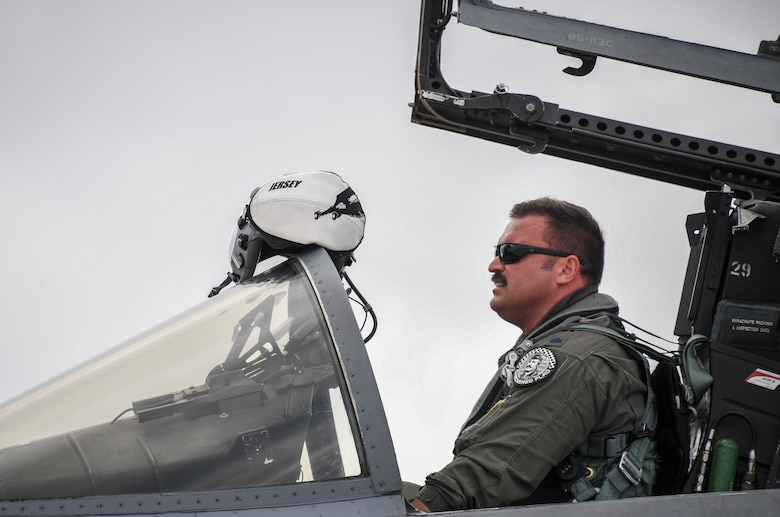 Lt. Col. Jonathan Burd, 194th Fighter Squadron pilot, puts on his helmet for his return home flight after  exercise Checkered Flag concluded, Tyndall Air Force Base, Florida, Nov. 10, 2020.