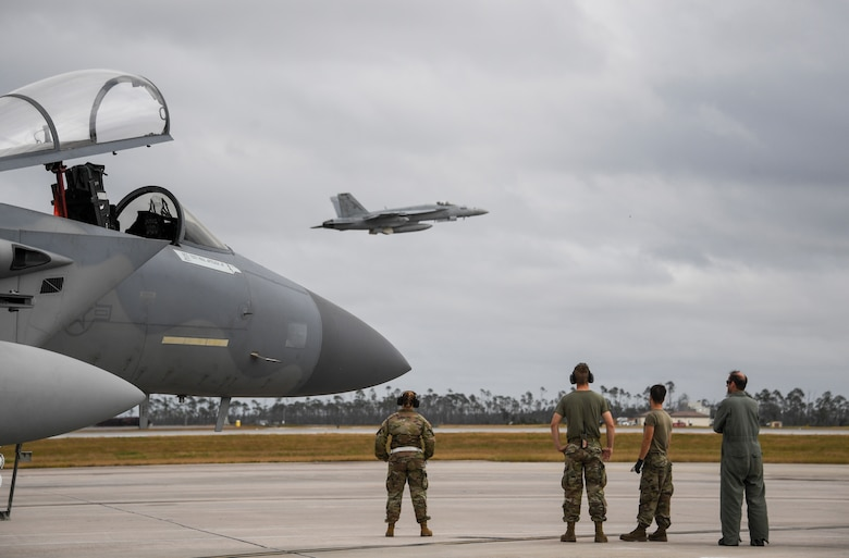 U.S. Air Force Airmen from the 144th watch a U.S. Navy F/A-18E Super Hornet fighter jet depart   Tyndall Air Force Base, Florida, Nov. 10, 2020 after the conclusion of  Checkered Flag.