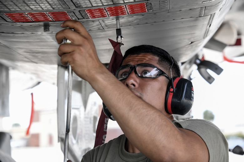 Airman 1st Class Jesus Molina-Serrato, 144th Maintenance Squadron, checks the countermeasures of a U.S. Air Force F-15C Eagle fighter jet after it returned from a sortie during Checkered Flag, Tyndall Air Force Base, Florida, Nov. 9, 2020.
