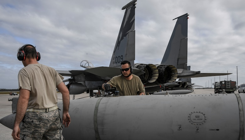 Tech. Sgt. Cory Snyder, 144th Maintenance Squadron, prepares an external fuel tank to be loaded on a U.S. Air Force F-15C Eagle fighter jet during Checkered Flag, Tyndall Air Force Base, Florida, Nov. 9, 2020.