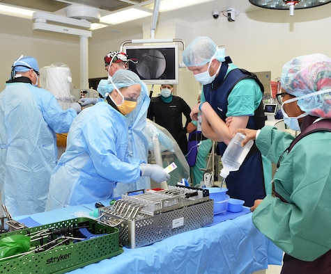Members of the 555th Forward Resuscitative Surgical Team helping the CRDAMC surgical team in prepping for surgery.